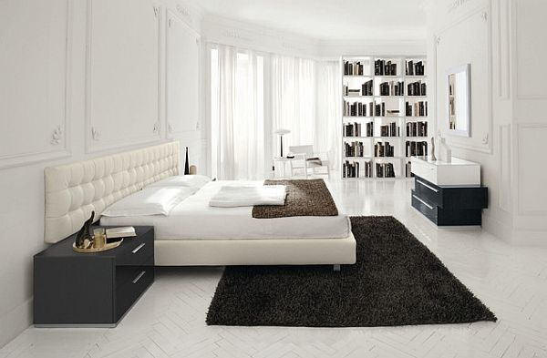white bedroom with dark colored rug