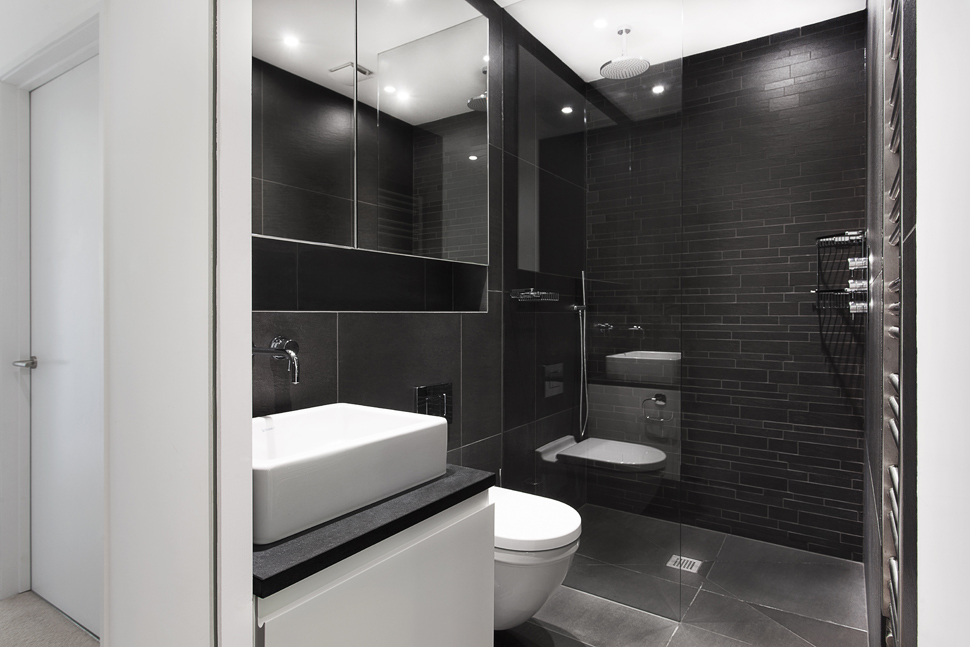 modern-addition-grey-living-box-and-timber-sleeping-cube-11 How to design a powder bathroom?