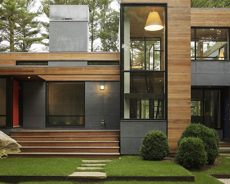 captivating-home-architecture-design-ideas-feats-flat-rooftop-and-extensive-glass-wall-along-with-low-teak-stairs-beside-stone-pathways