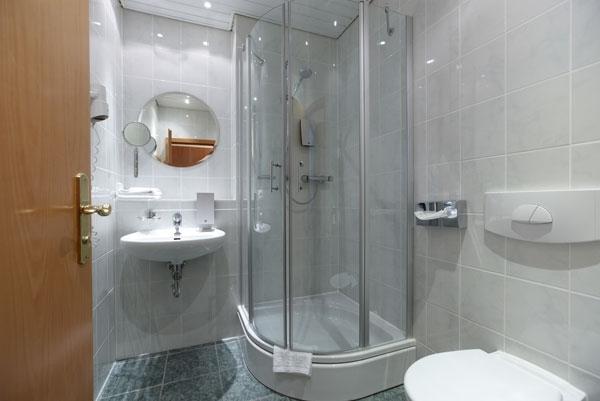 small-shower-ideas-small-bathroom-designs-corner-shower-cabin-sliding-doors