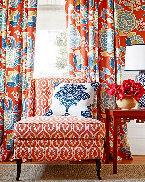 Cosy-decoration-in-red-and-blue-with-big-floral-motifs